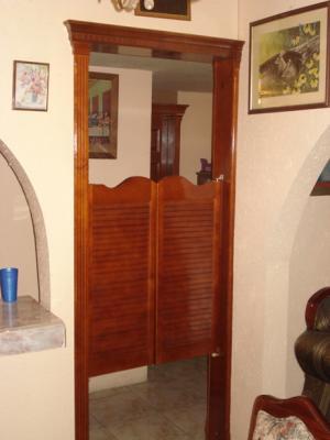 Puertas tipo cantina con marco closets cocinas y - Pomos para puertas de cocina ...